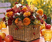 Arrangement of dahlias & chrysanthemums in rectangular basket