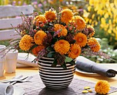 Vase of dahlias, heather and hypericum berries