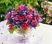 Spring arrangement of azaleas and grape hyacinths