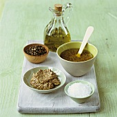 Mustard dressing with ingredients (Dijon mustard, salt, pepper, oil)