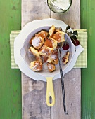Kaiserschmarrn (chopped pancake dessert) with sour cherries