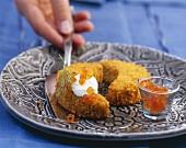 Crispy potato croquettes with salmon trout caviar