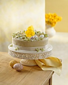 Easter cake with sugar eggs and daffodil