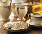 Heart-shaped Springerle (cookies) & gold-rimmed coffee set