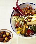 Vegetable salad with vegetarian sausage