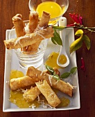 Coconut rolls with mango filling and passion fruit sauce