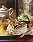 Crispy roast Peking duck on flatbreads