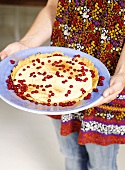 Cranberry tart sprinkled with cinnamon