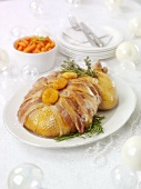 Bacon-wrapped roast goose for Christmas