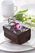 Chocolate slice decorated with horned violet
