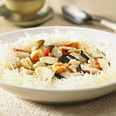 Seafood and mushroom stir-fry on rice noodles