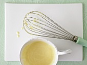Whisk with sauce