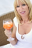 Blond woman with cocktail