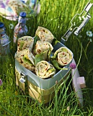 Wraps in a lunch box in grass