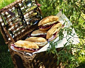 Brie sandwiches in a picnic basket