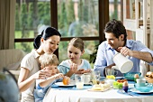 Family of four at breakfast table