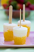 Home-made yoghurt and peach ice lollies
