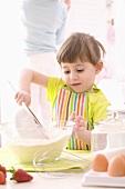 Girl sieving flour into a bowl