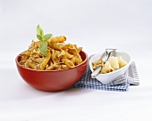 Penne with pesto rosso, Parmesan and pine nuts
