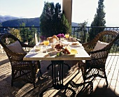 Table laid for breakfast on a terrace