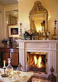 Fireplace with burning fire in a living room