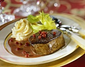 Venison steak with cranberry sauce and celery puree