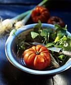 Beefsteak tomato and winter purslane in strainer
