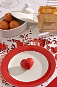 Place-setting with hearts, boiled eggs and toast