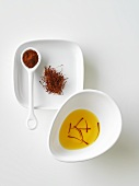 Saffron threads: in a small dish of water, dried & ground