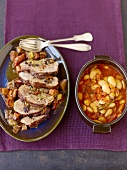 Provençal roast lamb with bean and tomato pot-au-feu