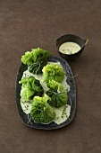 Savoy cabbage purses with polenta filling & onion cream sauce