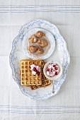 Cinnamon waffles with cranberry cream, Schlosserbuben (prune fritters)