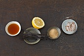 Ingredients for tea: caramel syrup, lemon, vanilla pods etc.