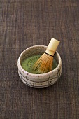 Bowl of matcha tea and bamboo whisk (Japan)