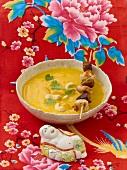 Cream of pumpkin soup with chicken skewer