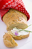Home-made sunflower bread, one slice with quark