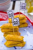 Fish fingers with Jolly Roger flags