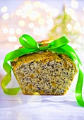Poppy seed loaf cake with green ribbon for Christmas