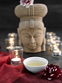 Green tea with tealights and stone figure