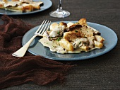 Scorzonera with oysters and oyster mushrooms in wine sauce
