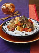 West Indian beef curry on rice noodles