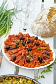 Baked red peppers with olives (Bulgaria)