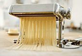 Pasta maker cutting ribbon pasta