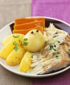 Skate wing with cream sauce, onion, potatoes and carrots