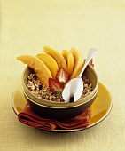 Muesli with melon and peach slices and strawberries