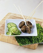 Minced lamb on skewers and cucumber salad