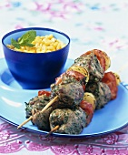 Mutton and vegetable kebabs and sweetcorn