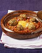 Kofta tajine with tomatoes and fried egg (Morocco)