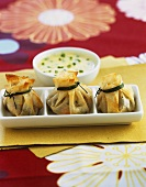 Brik pastry purses with prawn & mushroom filling, chive sauce