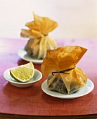 Brik pastry purses with salmon and spinach filling